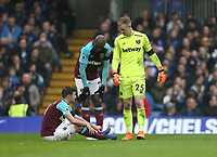 West Ham United's Angelo Ogbonna and Joe Hart show concern for Aaron Cresswell<br /> <br /> Photographer Rob Newell/CameraSport<br /> <br /> The Premier League - Chelsea v West Ham United - Sunday 8th April 2018 - Stamford Bridge - London<br /> <br /> World Copyright &copy; 2018 CameraSport. All rights reserved. 43 Linden Ave. Countesthorpe. Leicester. England. LE8 5PG - Tel: +44 (0) 116 277 4147 - admin@camerasport.com - www.camerasport.com