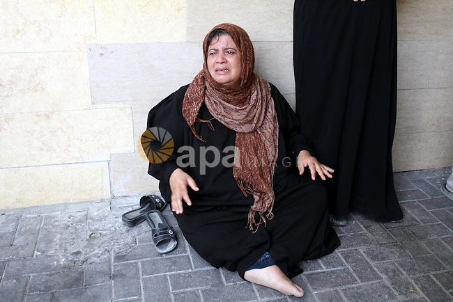 A Palestinian woman reacts outside a hospital after her son was wounded in an Israeli air strike in Gaza City August 20, 2011. The Arab League will hold an urgent meeting on Sunday to discuss an Israeli air strike on the Gaza Strip that killed 15 Palestinians, a spokesman said. Photo by Mohammed Asad