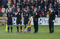 Officials consult each other as there appears to be confusion about the minute's silence ahead of the Sky Bet League 2 match between Newport County and Carlisle United at Rodney Parade, Newport, Wales on 12 November 2016. Photo by Mark  Hawkins.