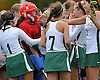 Carle Place goalie Megan McGuinness (red uniform and helmet) and teammates celebrate after their 5-0 win over Oyster Bay in the Nassau County varsity field hockey Class C final at Adelphi University on Sunday, November 1, 2015.<br /> <br /> James Escher