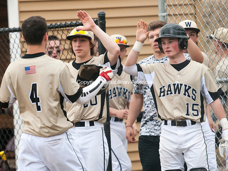 BEACON FALLS, CT-11 April 2014-041114EC15-  Woodland's Sam Merriman gets congratulations from teammates after he scores against Crosby in Beacon Falls Friday. Erin Covey Republican-American