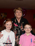 Pat Donaghy celebrating her 70th birthday in Tommy Hanratty's with all grandchildren  Joe Hart and Holly Boyle. Photo:Colin Bell/pressphotos.ie