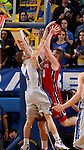 BROOKINGS, SD - JANUARY 17:  Jake Bittle #4 from South Dakota State University blocks the shot of James Hunter #50 from the University of South Dakota in the first half of their game Saturday afternoon at Frost Arena in Brookings. (Photo by Dave Eggen/Inertia)