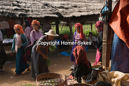 Lake Inle. Pa O tribal women wearing traditional turbans at village market. Myanmar Burma 2006.