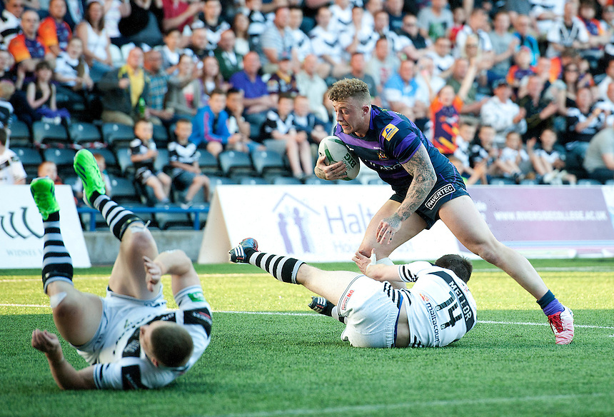 Wigan Warriors' Josh Charnley recovers from the tackle by Widnes Vikings' Joe Mellor <br /> <br />  (Photo by Stephen White/CameraSport) <br /> <br /> Rugby League - Super League - Widnes Vikings v Wigan Warriors - Friday  7th June 2013 - Stobart Stadium - Halton<br /> <br /> &copy; CameraSport - 43 Linden Ave. Countesthorpe. Leicester. England. LE8 5PG - Tel: +44 (0) 116 277 4147 - admin@camerasport.com - www.camerasport.com
