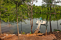 A pontoon boat sits nestled inside an aluminum dock at Whipkins Cove, a vacation rental home on Tennessee's Watauga Lake.  Lake Watauga, located between Boone, NC, and Elizabethton, TN, is surrounded by Cherokee National Forest and is largely undeveloped. About a dozen homes are available for rent around the massive lake.
