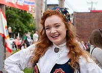 Beautiful girl wearing traditional Norwegian clothing, 17th of May Festival 2016, Ballard, Seattle, WA, USA.