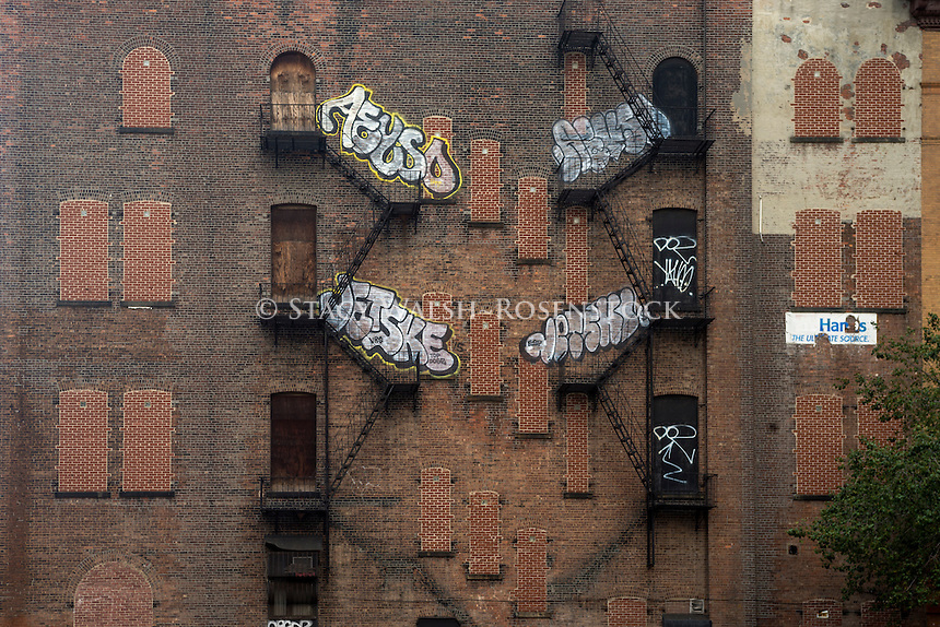 New York, NY 30 August 2015 - Vacant tenement building with graffiti and fire escapes on the Lower East Side