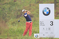 Cao Yi (CHN) tees off the 3rd tee during Thursday's Round 1 of the 2014 BMW Masters held at Lake Malaren, Shanghai, China 30th October 2014.<br /> Picture: Eoin Clarke www.golffile.ie