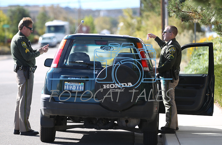 Carson City Sheriff's officials search a car believed to belong to Rachel Darlene Barrett, 30, who was arrested after allegedly robbing a Nevada State Bank in Carson City, NV. on Tuesday, Oct. 11, 2011..Photo by Cathleen Allison