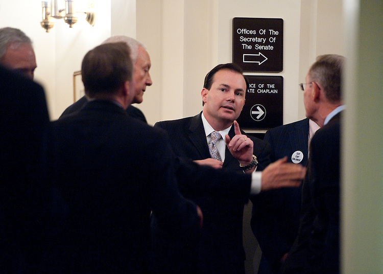 UNITED STATES - JULY 21: Sen. Mike Lee, R-Utah, organizes Senate and House Republicans in a back hallway before heading to the Senate Radio-TV Gallery studio for their news conference to call on the Senate to pass the cut, cap and balance bill on July 21, 2011. (Photo By Bill Clark/Roll Call)