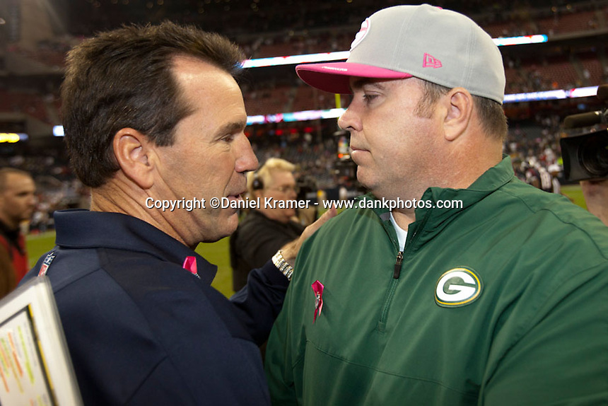 Texans Coach Gary Kubiak and Packers Coach Mike McCarthy meet midfield after the Packers defeated the Texans 42-24 at Reliant Stadium on Oct. 14, 2012