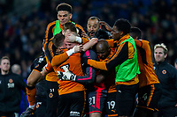 John Ruddy of Wolverhampton Wanderers celebrates his side's win with his team-mates and manager Nuno Espirito Santo (top) at full time during the Sky Bet Championship match between Cardiff City and Wolverhampton Wanderers at the Cardiff City Stadium, Cardiff, Wales on 6 April 2018. Photo by Mark  Hawkins / PRiME Media Images.