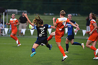 Kansas City, MO - Saturday May 07, 2016: Houston Dash defender Rebecca Moros (4) clears the ball against FC Kansas City forward Shea Groom (2) during a regular season National Women's Soccer League (NWSL) match at Swope Soccer Village. Houston won 2-1.