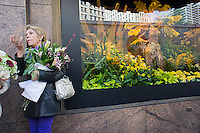 The windows of Macy's flagship department store in Herald Square in New York are seen decorated for their annual Macy's Flower Show on Monday, March 26, 2012. The show, whose theme this year is Brazil and its tropical flowers will take place in a 5000 square foot tent set up outside the store on Broadway because of ongoing major renovations to the store. (© Richard B. Levine)