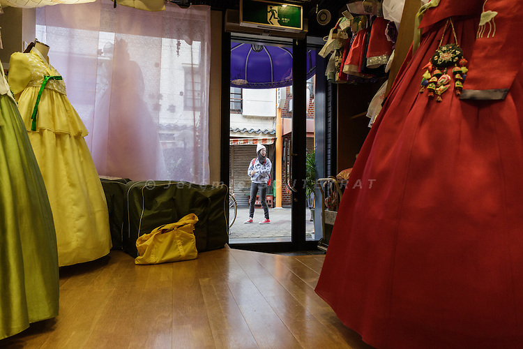 Osaka, Japan, November 25 2016 - A family run kimono shop, owned by Pu Kyon-ja, in Osaka&rsquo;s Korea town of Tsuruhashi, the home of the largest Korean community (Zainichi) in Japan.<br /> The majority of Koreans in Japan are Zainichi Koreans, often known simply as Zainichi , who are the permanent ethnic Korean residents of Japan. The term &quot;Zainichi Korean&quot; refers only to long-term Korean residents of Japan who trace their roots to Korea under Japanese rule, distinguishing them from the later wave of Korean migrants who came mostly in the 1980s. The estimated population is about 500,000 people. As of 2016, about 90% of them have South Korean nationality and 10% of them are considered by Japanese administration as &laquo;&nbsp;Korean&nbsp;&raquo; (chosenjin), the word used for korean people before the division between North and South Korea in 1948. The ratio used to be the opposite in the 1950ies.