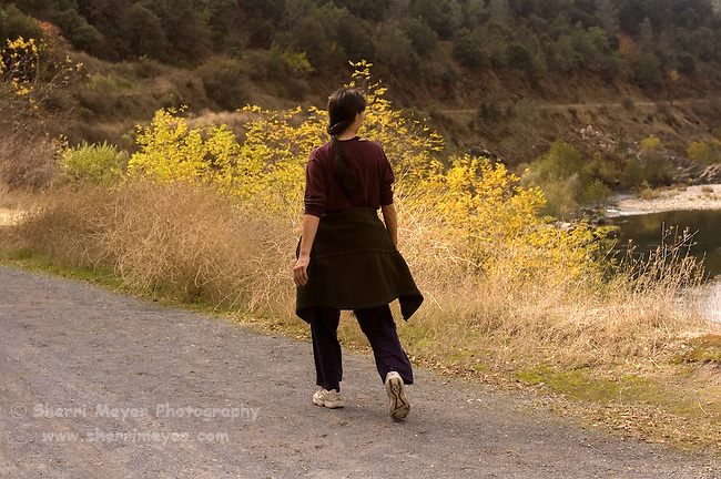 Woman walking on the Quarry trail, Auburn State Recreation Area, California