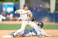 University of Washington Huskies Braiden Ward (7) slides into second base while Hank LoForte (9) makes a throw to first base at Goodwin Field on June 09, 2018 in Fullerton, California. The Cal State Fullerton Titans defeated the University of Washington Huskies 5-2. (Donn Parris/Four Seam Images)