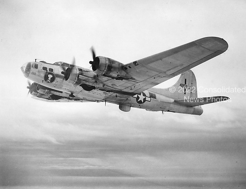 The B-17 is one of the most recognizable bomber aircraft of World War 2. During its production run, over 12,731 B-17's were built in various configurations. The B-17F was essentially a production version of the B-17E after all the improvements and modifications were incorporated into the design. The defensive armament was increased to eleven .50-caliber machine guns including increased frontal protection in the form of cheek guns. More powerful engines and improved propellers allowed for a maximum bomb load of 8,000 pounds. The B-17F could carry almost double the bomb load of any previous version, but the normal cruise speed dropped by almost 70 mph. due to a large increase in aircraft gross weight. Three thousand four hundred and five -F models were built by three manufacturers: Boeing (2300), Douglas (605) and Lockheed-Vega (500).  Like the B-17E, combat experience pointed out problems with B-17F design which were rapidly fixed during the production run. Major improvements done while the B-17F was in production included the addition of external bomb racks, cheek guns (initially a mod center improvement), and the Bendix chin turret which became a standard on the B-17G. Only a few remain with about a dozen in flying condition.  A total of 3405 B-17Fs were built--2300 by Boeing, 605 by Douglas, and 500 by Lockheed-Vega..Credit: U.S. Air Force via CNP