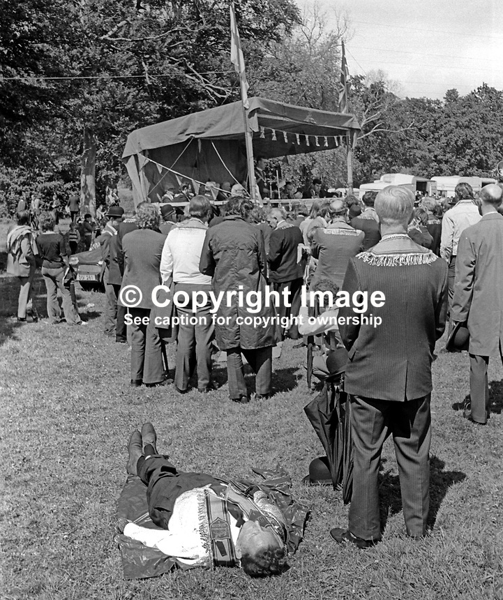 Listening to speakers at The Field at Edenderry, the venue for Belfast &amp; District Orangemen's annual Twelfth Parade - well not quite everyone! 12th July 1974, 197407120383k<br /> <br /> Copyright Image from Victor Patterson, 54 Dorchester Park, Belfast, UK, BT9 6RJ<br /> <br /> Tel: +44 28 9066 1296<br /> Mob: +44 7802 353836<br /> Voicemail +44 20 8816 7153<br /> Email: victorpatterson@me.com<br /> Email: victorpatterson@gmail.com<br /> <br /> IMPORTANT: My Terms and Conditions of Business are at www.victorpatterson.com