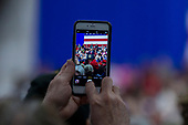 A supporter takes a cell phone picture as United States President Donald J. Trump speaks during a Make America Great Again campaign rally at Atlantic Aviation in Moon Township, Pennsylvania on March 10th, 2018. Credit: Alex Edelman / CNP