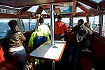 MV Dunter III, The Noss Boat, Shetland islands, Scotland. Passengers onboard in cabin.
