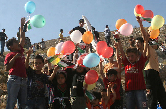 A Palestinians flying balloons over the Israeli settlement of Yitzhar during a demonstration in the village of Burin in the West Bank near the city of Nablus on July 7, 2009. Photo by Nedal Shtieh