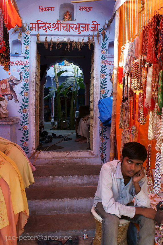 shop owner waits for costumer in front of his shop in holy city Pushkar, Rajastan, India
