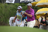 The heavens open but Lee Westwood (ENG) plays on during the Final Round of the 2014 Maybank Malaysian Open at the Kuala Lumpur Golf & Country Club, Kuala Lumpur, Malaysia. Picture:  David Lloyd / www.golffile.ie