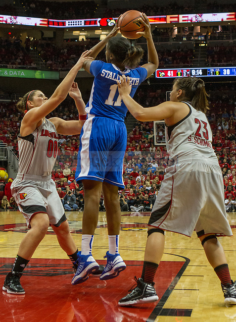 UK's junior center, DeNesha Stallworth, draws a foul from Louisville's Sara Hammond as she goes up for a shot.in Louisville, Ky., on Sunday, December, 2, 2012. Photo by James Holt | Staff