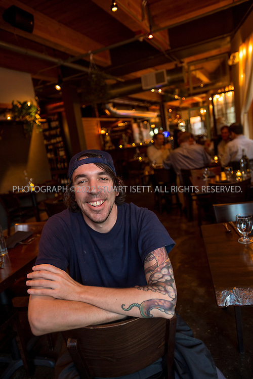 10/16/2014&mdash;Seattle, WA, USA<br /> <br /> Derek Ronspies, owner and chef at Le Petit Cochon in Seattle&rsquo;s Fremont neighborhood, posing in the restaurant.<br /> <br /> Photograph by Stuart Isett<br /> &copy;2014 Stuart Isett. All rights reserved.
