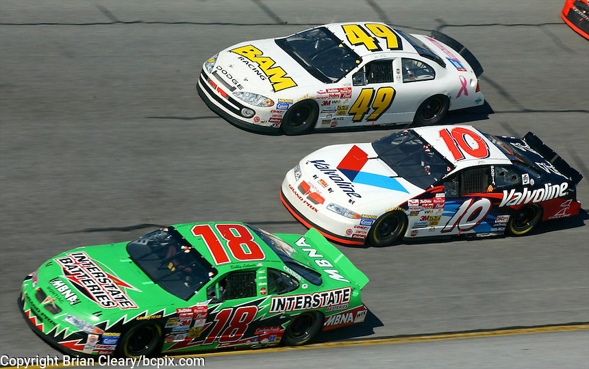 Bobby Labonte (18) leads Johnny Benson (10) and Shawna Robonson (49) during the Daytona 500, Daytona International Speedway, Daytona Beach, FL, February 17, 2002.  (Photo by Brian Cleary/www.bcpix.com)