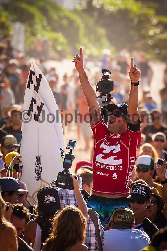 HONOLULU - (Friday, December 14, 2012) -- The BILLABONG PIPE MASTERS In Memory of Andy Irons  concluded today in spectacular way. The 2012 ASP World Title was decided between Joel Parkinson (AUS) and Kelly Slater (USA) with Parkinson finally holding the World Title trophy above his head in front of thousands of surf fans..Slater was defeated by Josh Kerr (AUS) in the semi finals finishing his chance of winning a 12th World Title. Waves were  in the 6 to 8-feet for most of the day..Sebastien Zietz (HAW) won the 2012 Vans Triple Crown of Surfing title winning $100,000, a Harley Davidson motorcycle and a $10,000 Nixon watch..Photo: joliphotos.com