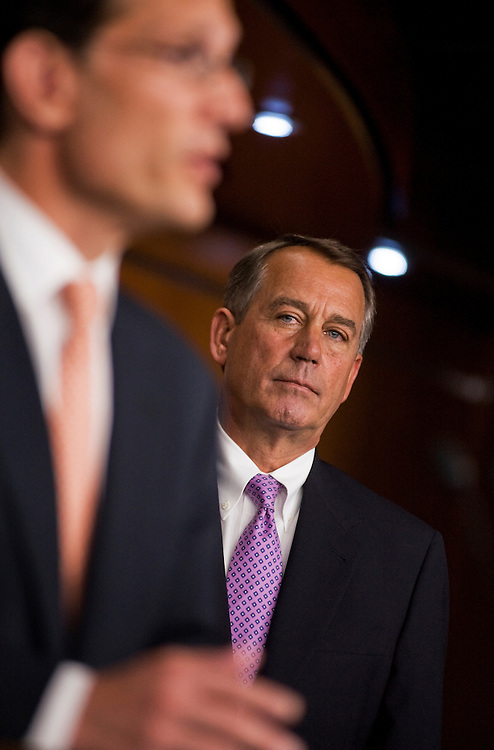 UNITED STATES - JULY 14:  Speaker John Boehner, R-Ohio, right, and House Majority Leader Eric Cantor, R-Va., conduct a news conference with other House republicans in the Capitol Visitor Center on the topics of a proposed balanced budget amendment and also the ongoing debt ceiling talks.  (Photo By Tom Williams/Roll Call)