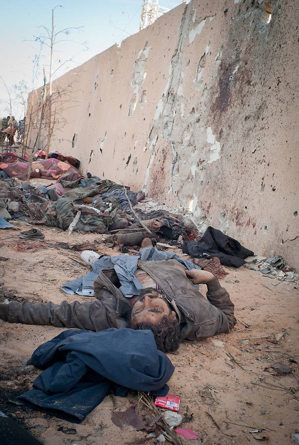 Aftermath of NATO strike on the convoy of Gaddafi loyalists that attempted to leave Sirte, Libya, October 20, 2011. The government forces declared victory in Sirte after a month long battle, bringing an end to the 8 month revolutionary war.