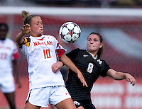 Riley Barger (10) of Maryland fights for the ball with Ally Berry (8) of Wake Forest during the game at Ludwig Field in College Park, MD.  Maryland defeated Wake Forest, 1-0.