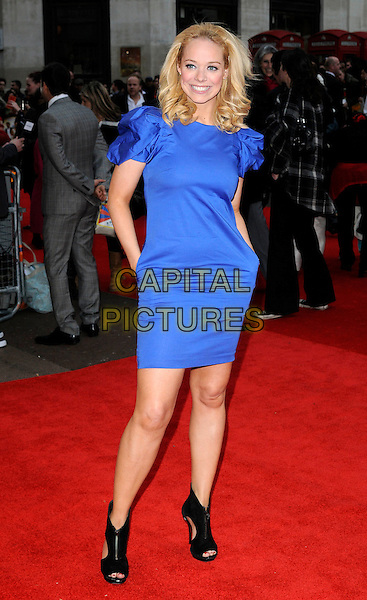 """LIZ McCLARNON.The """"It's A Wonderful Afterlife"""" UK premiere, Odeon West End, Leicester Square, London, England. .April 12th, 2010.full length blue dress shoulders black ankle boots open toe cut out sides hands in pockets  .CAP/CAN.©Can Nguyen/Capital Pictures."""