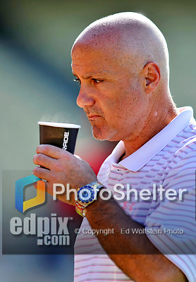 22 July 2011: Washington Nationals General Manager Mike Rizzo takes in batting practice prior to a game against the Los Angeles Dodgers at Dodger Stadium in Los Angeles, California. The Nationals defeated the Dodgers 7-2 in their first meeting of the 2011 season. Mandatory Credit: Ed Wolfstein Photo