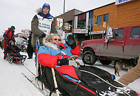 Junior Iditarod champion Jessica Klejka heads to the start line with honorary musher Max Lowe in Anchorage on Saturday March 1st during the ceremonial start day of the 2008 Iidtarod Sled Dog Race.