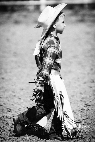 A youngster prepares to participate in the annual Ribbon Race at the Deer Trail Rodeo in Deer Trail, Colorado, home of the first rodeo. Youngsters must chase down and remove a ribbon tied around the tail of a calf.
