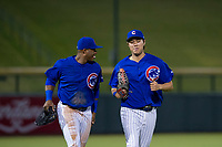 AZL Cubs center fielder Nelson Velazquez (20) and left fielder Kwang-Min Kwon (27) jog off the field between innings of the game against the AZL Angels on August 31, 2017 at Sloan Park in Mesa, Arizona. AZL Cubs defeated the AZL Angels 9-2. (Zachary Lucy/Four Seam Images)