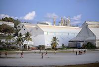 Men play Australian rules football in Nauru, South Pacific