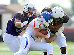 SIOUX FALLS, SD - SEPTEMBER 5: Clint Wilson #33 and David Clark #4 from the University of Sioux Falls brings down Adam Woroniecki #27 from the University of Mary in the first half of their game Saturday afternoon at Bob Young Field.  (Photo by Dave Eggen/Inertia)