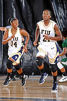 11 November 2011:  FIU's Timeyin Oritsesan (21) and Kamika Idom (14) run back up-court after a basket in the first half as the FIU Golden Panthers defeated the Jacksonville University Dolphins, 63-37, at the U.S. Century Bank Arena in Miami, Florida.