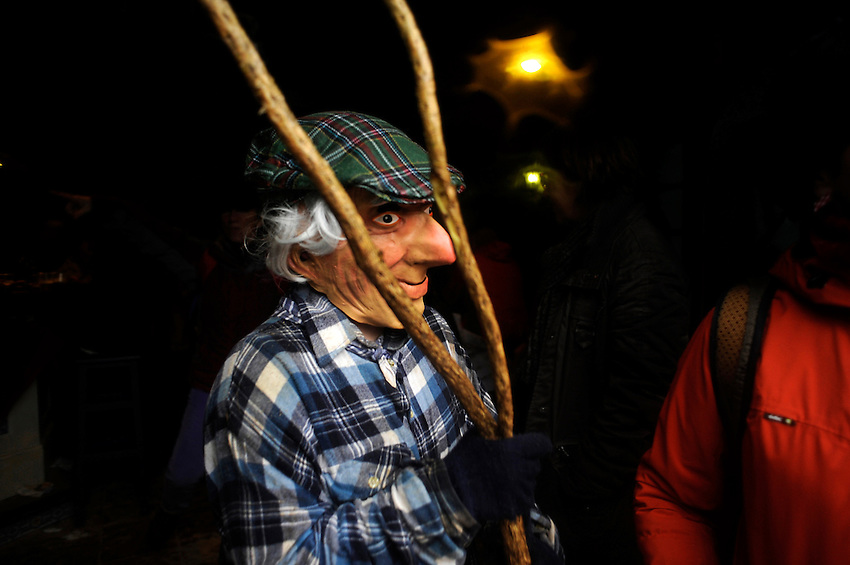 A masked person performs during an ancient carnival on January 27, 2014 at the village of Ituren, Basque Country. Joaldun groups perform an ancient traditional carnival at the villages of Ituren and Zubieta during two days, carrying sheep furs and big cowbells in their backs and making sound them in order to wake up the earth, to ask for a good new year, a good harvest and also to keep away the bad spirits. (Ander Gillenea / Bostok Photo)
