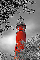 The Ponce Inlet lighthouse under a cloudy sky in Ponce Inlet, Florida, April 20, 2014.  Selective color (Red) digitally enhanced.  (Photo by Brian Cleary/ www.bcpix.com )