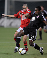 DC United forward Luciano Emilio (11) fights to keep possession of the ball against Charleston Battery midfielder Osvaldo Alonso (6), DC United defeated The Charleston Battery 2-1 to win the US. Open Cup, Wednesday September 3, 2008 at RFK Stadium.