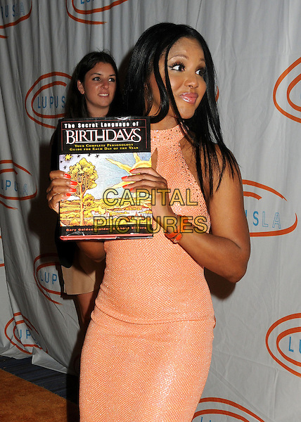 Toni Braxton.12th Annual Lupus LA Orange Ball held at the Beverly Wilshire Hotel, Beverly Hills, California, USA..May 24th, 2012.half length dress pink peach sleeveless book birthdays the secret language of.CAP/ADM/BP.©Byron Purvis/AdMedia/Capital Pictures.
