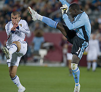 Colorado goalkeeper Bouna Coundoul (blue) clears a ball away from Salt Lake forward Yura Movsisyan. Real Salt Lake earned a tied versus the Colorado Rapids securing a place in the postseason. Dick's Sporting Goods Park, Denver, Colorado, October, 25, 2008. Photo by Trent Davol/isiphotos.com