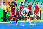 Lucas Rossi #27 of Argentina passes before Simon Gougnard #22 of Belgium can prevent during Argentina vs Belgium  in the men's gold medal game at the Rio 2016 Olympics at the Olympic Hockey Centre in Rio de Janeiro, Brazil.